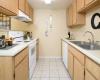 View of Kitchen with gas stove and appliances at Camelot Apartments